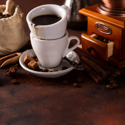 cup-of-steaming-hot-coffee-with-coffee-beans-coffe-PCYENJV